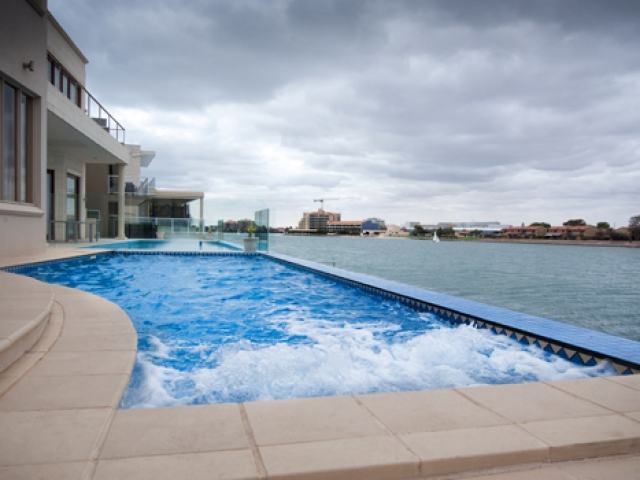 water jets in ground pool overlooking west lakes