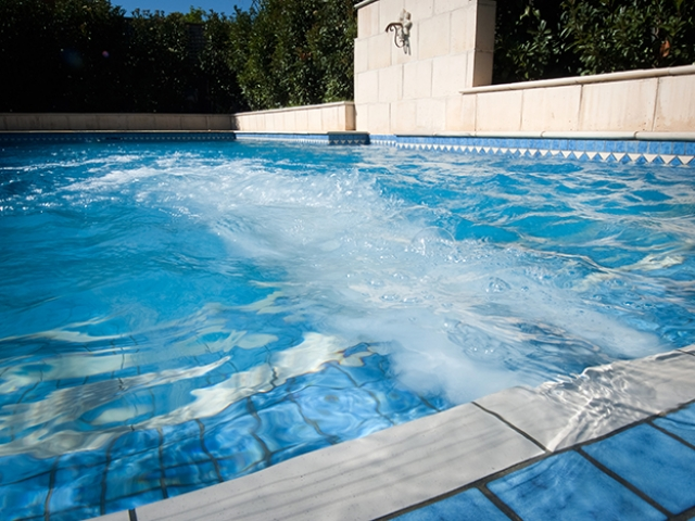 opulent water jet feature installation in ground pool