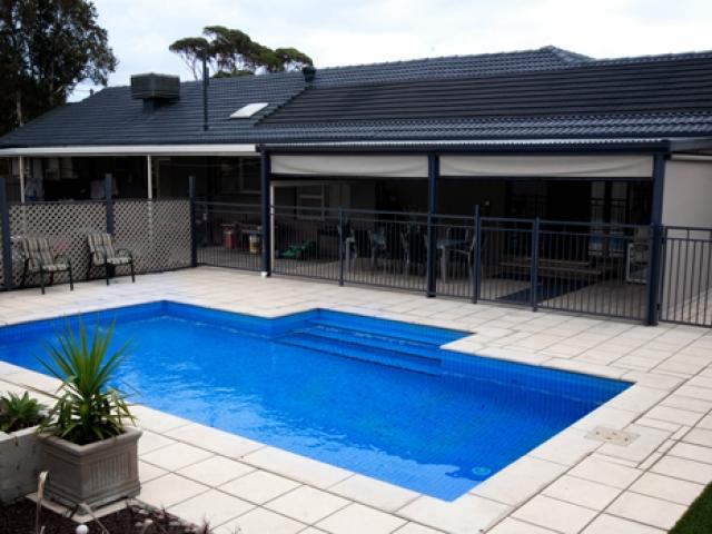 pool featuring overhead verandah and seating