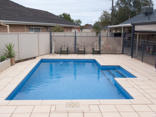 sandstone pavers with overhead verandah and outdoor seating
