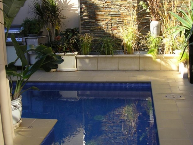 L shaped pool in afternoon lighting