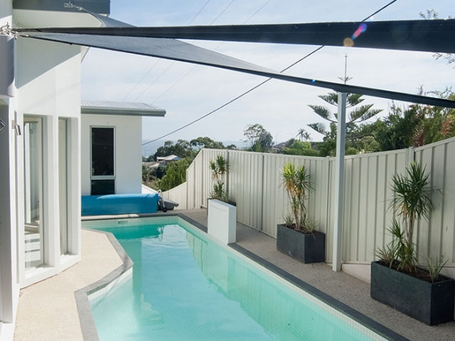 modern customised pool bespoke with shade sail