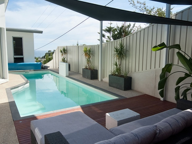customised in ground pool with elegant outdoor setting