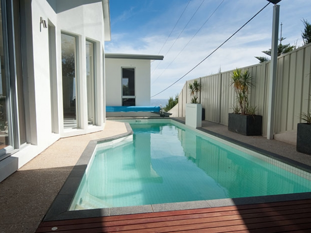 customised in ground pool with solar blanket