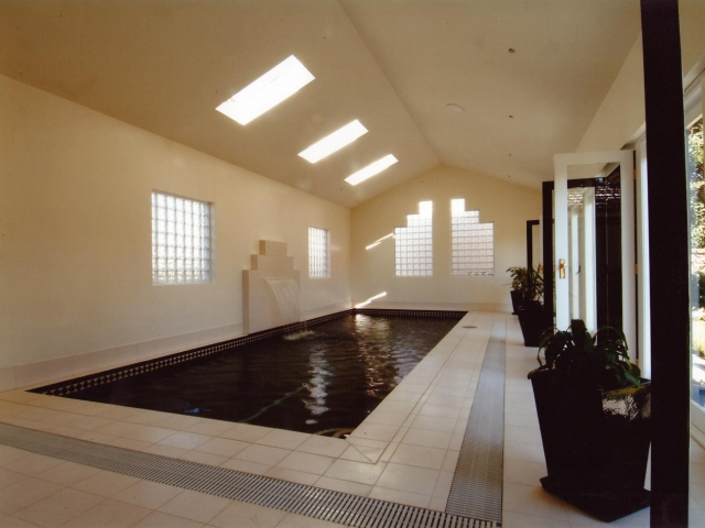 indoor pool with custom upright water feature fountain